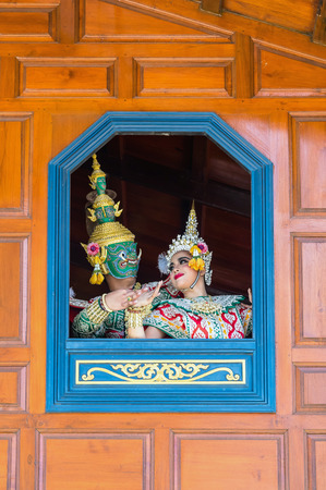 Khon, pantomime performances action of Thailand, a kind of Thai drama, Tos-sa-gan Giant performing action with beautiful si-da out of window at  Wat Phra Khao temple in Ayutthaya province