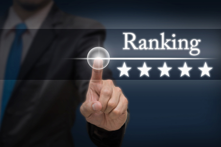 hotel reviews: Businessman pointing five star button to increase ranking of hotel on dark blue tone background, business evaluation concept, Increase rating