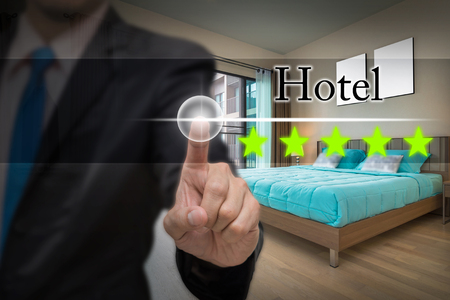 Businessman pointing five star button to increase rating of Luxury Interior bedroom room, business evaluation concept, Increase rating 版權商用圖片 - 70414243