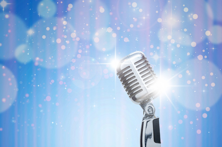Retro microphone over the Abstract photo of chrismas and blurred background, vintage musical concept