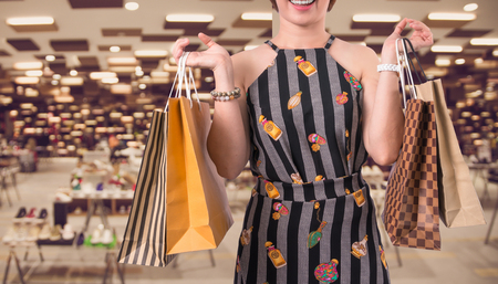 Happy woman shopping with happy feeling over the Abstract blurred photo of the bag and shoes store in a shopping mall department store, shopping concept Stock Photo