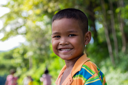 undefined: NAN, THAILAND - OCT 24 : Closeup Undefined asian happy boy smiling at BaanPaknai of countryside on October 24, 2016 in Nan province, Thailand