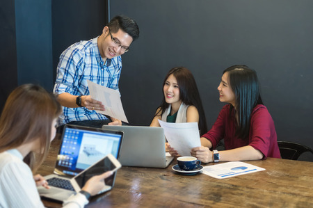 Group Of Asian Business people with casual suit brainstrom Meeting with technology equipment In the modern coffee shop, business group concept