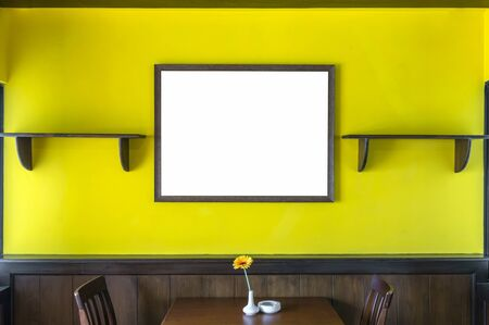 furnishings: Luxury restaurant set with yellow color wall with big photo frame, decirate concept Stock Photo