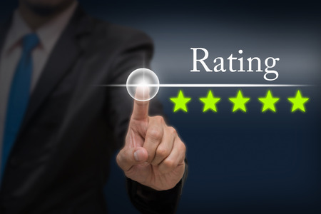 hotel reviews: Businessman pointing five star button to increase rating of hotel on dark blue tone background, business evaluation concept, Increase rating