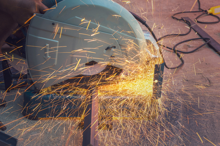 ductile: Closeup cutting process of metal material with sparks, industrial concept