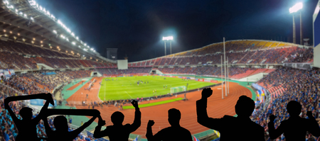 The silhouette of fan club over the panorama of Abstract blurred photo of fan sport at stadium, sport background concept