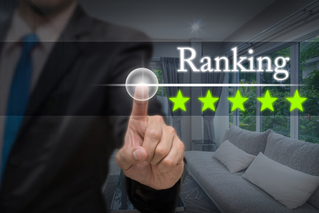 property management: Businessman pointing five star button to increase ranking of Luxury Interior living room, business evaluation concept, Increase rating