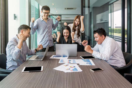 Group Of AsianBusiness people with casual suit working with happy action and celebrate in the modern Office, people business group concept