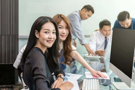 Group Of Asian Business people with casual suit working and talking together in the modern Office, people business group concept 스톡 콘텐츠