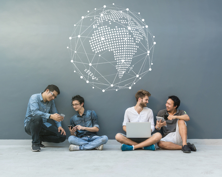 Group Of Asian and Multiethnic Business people with casual suit using each technology equipment with happy and celebrate action with Network graphic overlay banner at the outdoor over the wall background, people business group concept