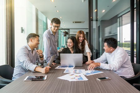 Group Of AsianBusiness people with casual suit working and brainstorming with happy action and celebrate in the modern Office, people business group concept