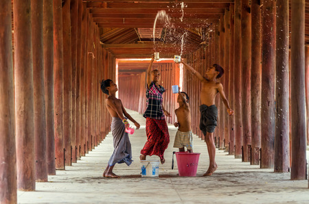 BAGAN, MYANMAR - March 10, 2016 : Undefined Burmese children playing the water with songkran festival in pagoda on March 19, 2016 in Bagin, myanmar