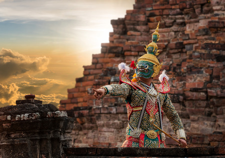 Khon, pantomime performances action of Thailand, a kind of Thai drama, Tos-sa-kan Giant at Ayutthaya temple at the sunset time, performing action concept, worm color tone