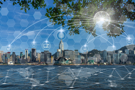Communication network with multichannel omni channel of Hong Kong Cityscape river side in the afternoon with smooth cloud at Victoria harbour, Technology Smart City with Internet of Things concept Stockfoto