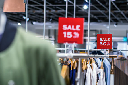 sale 50 off mock up advertise display frame setting over the clothes line in the shopping department store for shopping, business fashion and advertisement concept off mock up advertise display frame setting over the clothes line in the shopping department store for shopping, business fashion and advertisement concept