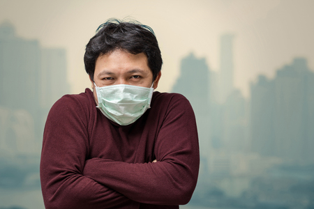 Asian man wearing the face mask against air pollution