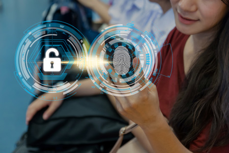 Closeup Women Fingerprint scan for biometric authentication to unlock security in the BTS Skytrain rails or MRT subway, Business Technology sceurity Concept.