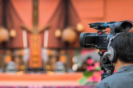 Closeup Video Cameraman taking photograp to the stage, event and seminar production equipment concept