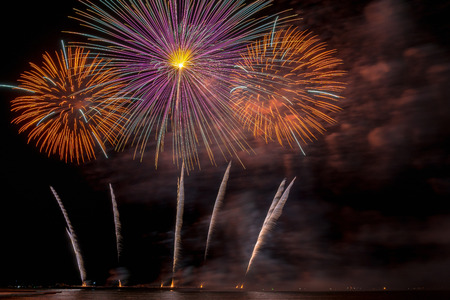 Fantastic Multicolor Firework Celebration from the big boat over the sea, celebration concept