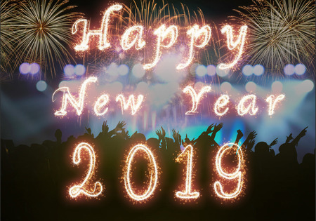Happy new year 2019 written with Sparkle firework on Concert crowd in silhouettes of Music fanclub with show hand action for celebrate with fireworks, Xmas celebration concept