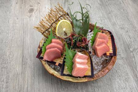 Top view of tuna sashimi set include Otoro, Chutoro and Akami with ice on the table, Luxury Japanese food concept