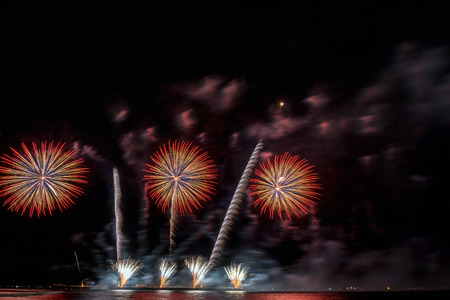 Fantastic Multicolor Firework Celebration from the big boat over the sea, celebration concept