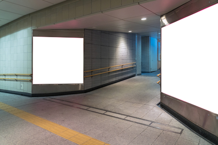 Walkway with Blank billboard located in underground hall or subway for advertising, mockup concept, Low light speed shutter