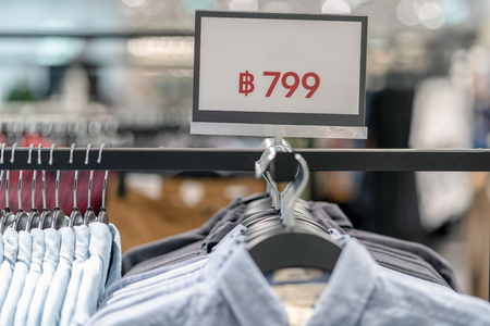 Sale off mock up advertise display frame setting over the clothes line in the shopping department store for shopping, business fashion and advertisement concept