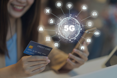 Closeup Asian woman using credit card by mobile for 5G technology with various icon internet of thing in department store, IOT and cashless concept, credit card mockup
