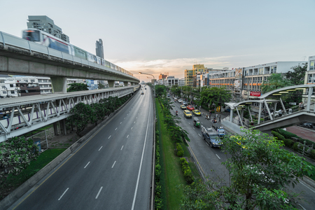 BANGKOK, THAILAND - DEC 2018 : Transportation Railroad station with traffic jam and elevated train metro system in rush hour at sunset time on December 25, 2018 in Bangkok, Thailand