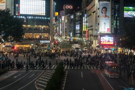 TOKYO, JAPAN - OCTOBER 2017 : Undefined Japanese people crowd are walking the cross-walk shibuya crosswalk on October 26, 2017 in Tokyo, Japan.