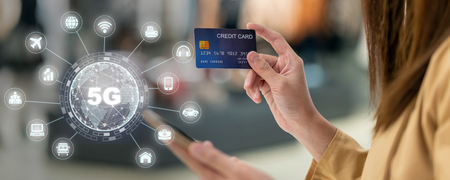 banner of Asian woman using credit card by mobile for 5G technology with various icon internet of thing in department store, technology money wallet and online payment concept, credit card mockup