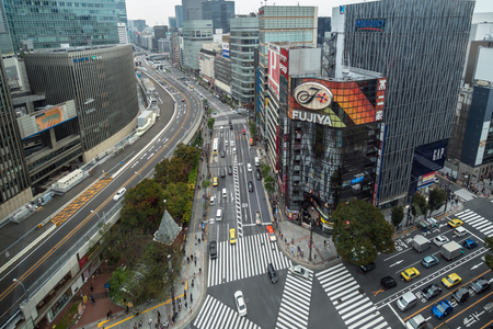TOKYO, JAPAN - OCTOBER 2017 : Top view of Undefined Japanese people crowd are walking to crosses the street between the buildings of Ginza JR station which is district on October 28, 2017 in Tokyo, Japan. Editorial