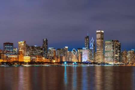 Chicago Cityscape river side along Lake Michigan at beautiful twilight time, Illinois, United States, Business Architecture and building with tourist concept