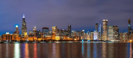 Panorama of Chicago Cityscape river side along Lake Michigan at beautiful twilight time, Illinois, United States, Business Architecture and building with tourist concept