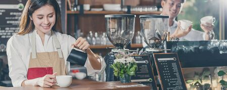 Banner of Asian Barista preparing cup of coffee, espresso with latte or cappuccino for customer order in coffee shop,bartender pouring milk,Small business owner and startup in coffee shop concept