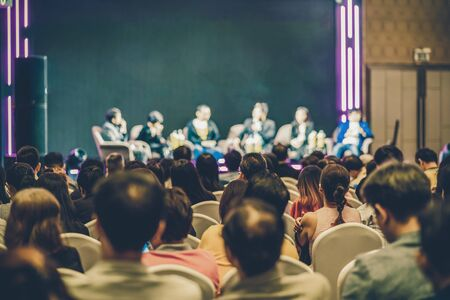 Rear view of Asian audience joining and listening group of speaker talking on the stage in the seminar meeting room or conference hall, business and education, associate and startup business concept Banco de Imagens