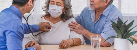 Bnner or web cover of Doctor using stethoscope for auscultate Asian grandparent patient in house, service Life insurance at home, healthcare with Long live and Elderly society,Prevent epidemic concept
