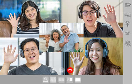 Asian Business people saying hello with teamwork colleague and couple Grandparent in video call conference screen by mobile phone when Covid-19 pandemic, Social distancing and new normal concept
