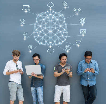Group Of Asian and Multiethnic Business people using each technology equipment brainstorming for Polygonal brain shape of an artificial intelligence with various icon of smart city Internet of Things Zdjęcie Seryjne