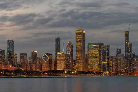 Panorama of Chicago Cityscape river side along Lake Michigan at beautiful twilight time, United States,building and real estate,Business Architecture and building,travel and tourist concept,reflection