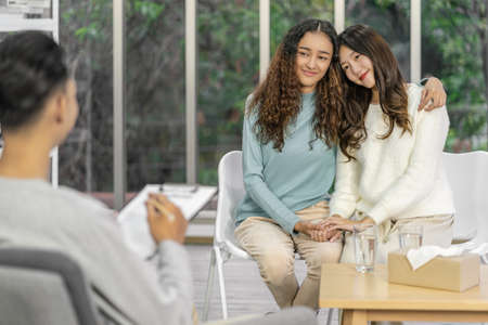 Senior Asian Manager receiving the resume document from Young Asian woman graduate before start to job interview with positive motion in meeting room,Business Hiring new member concept