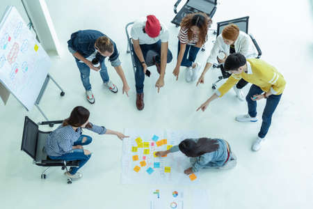 Top view Group of diversity people with casual suit brainstorming together in the workplace