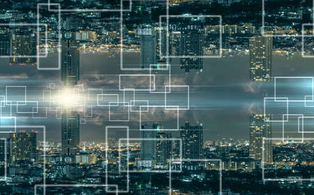 Technology Internet of thing over the Panorama of Bangkok cityscape at night time, Business Architecture and building with tourist, Technology smart city and internet of thing concept,