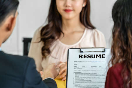 Young Asian woman waiting to sign the contract with two manager with positive motion in meeting room,Job interview agreement, Business Hiring new member concept