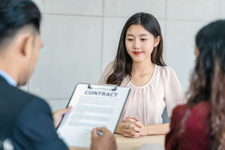 Young Asian woman waiting to sign the contract with two manager with positive motion in meeting room,Job interview agreement, Business Hiring new member concept Zdjęcie Seryjne - 164249530