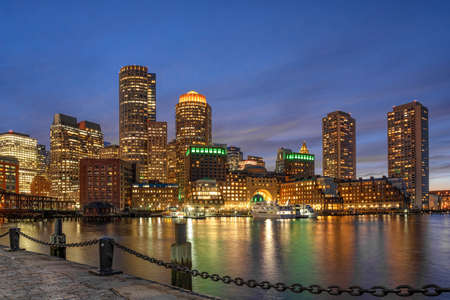Boston skyline from Fan Pier at the fantastic twilight time with smooth water river in boston, Massachusetts, USA downtown skyline, Architecture and building with tourist and travel concept