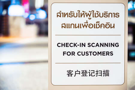 pandemic, new normal Concept, Check-in Scanning for customer text with Thai and Chinese Language on the Billboard before walking in department store