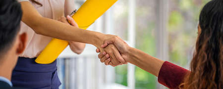 Banner of Closeup handshake when interview between Young Asian woman and two manager with positive motion in meeting room,Business Hiring new member concept Zdjęcie Seryjne